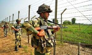 "Indian Border Security Force (BSF) soldiers take up positions at an outpost along a fence at the India-Pakistan border in R.S Pora south-west of Jammu on October 2, 2016. India has evacuated thousands of people near the Pakistani border in Punjab state following the military raids on militant posts, which provoked furious charges of ""naked aggression"" from Pakistan. The move followed a deadly assault on one of India's army bases in Kashmir that New Delhi blamed on Pakistan-based militants, triggering a public outcry and demands for military action. / AFP PHOTO / TAUSEEF MUSTAFA"